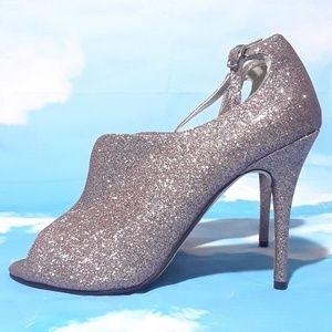Caparro's glitter peep toe heels